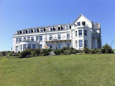 Photo for 1 Bedroom Apartment With Stunning Sea Views, Private Gardens And Tennis Court