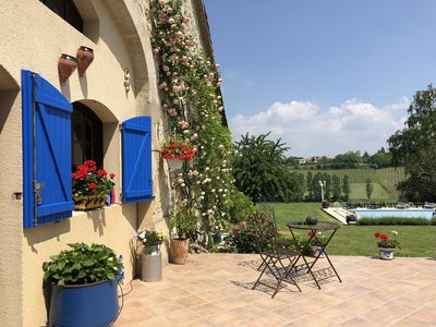 The converted Barn main terrace-stunning views across private pool to vineyards