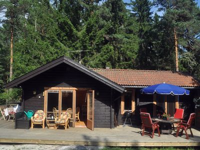 Photo for Cozy cottage with a view over lake & nature.Walking distance to sea & sand beach