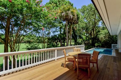 Pool and deck with golf course views