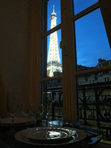1.From this French style window, an open spectacular view of Eiffel tower at night