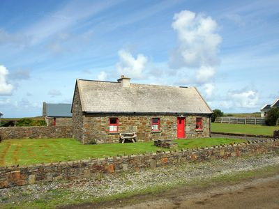 Photo for Traditional stone cottage on the scenic Loop Head peninsula famed for its natural beauty, tran…