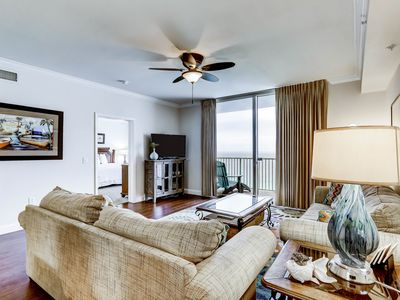 Photo for Inviting gulf-front condo w/ beach service, pools, hot tubs & fitness center!