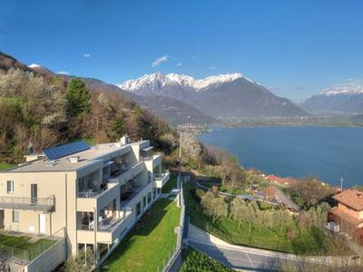 Photo for This modern holiday apartment in the Wellness Resort Valarin Lake Como is located in a fantastic pan
