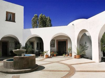 Photo for Spectacular house,  6 bedrooms, pool, gardens, great views, 10 min from downtown