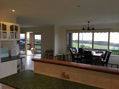 View from kitchen to dining and out to deck ocean