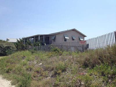 Photo for 1950s beach cottage -unbeatable beach frontage