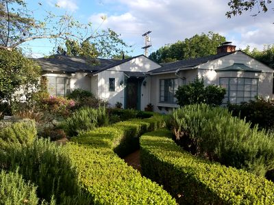 Charming 1936 Vintage Ranch House with pool and grass yard.