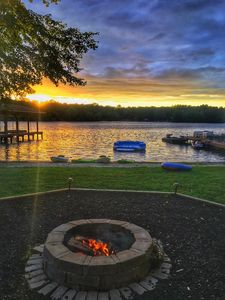Enjoy beautiful sunset over the water at the fire pit.