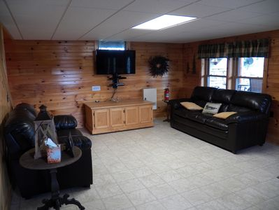 Additional TV area with access to walk out patio