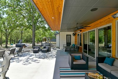 Spacious covered porch with both heaters and fans!