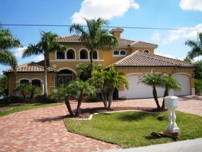 Photo for Luxurious villa with stunning pool area by a canal in Cape Coral Florida