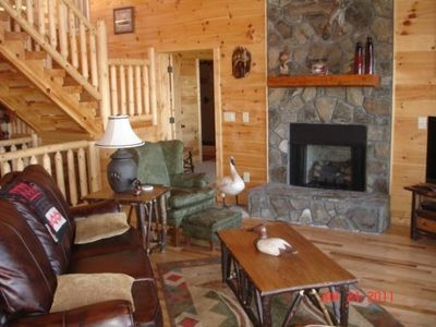 Enjoy a cozy fire in the living room of this great log vacation home.