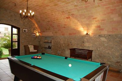 In the large hall on the ground floor, there is a pool table