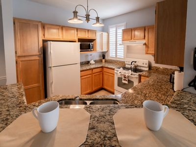 Photo for Cozy apartment only miles from Disney community pool and Jacuzzi