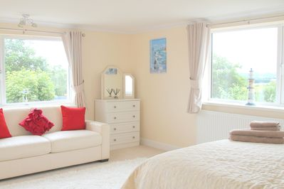 Bright and cheerful Master bedroom with triple aspect window and stunning views