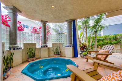 Private in-ground spa retreat patio with pull curtains.  Great place to unwind.