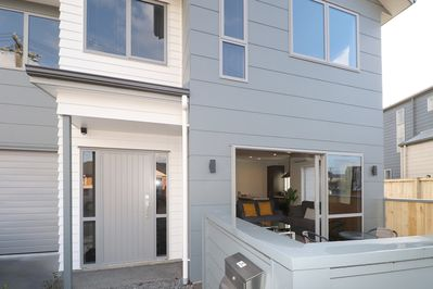 Front entrance and private fenced patio outdoor area from the lounge