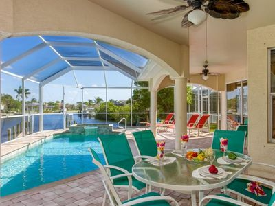 Photo for SW Cape Coral | Gulf Access | Pool & Jacuzzi with canal views
