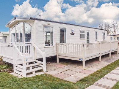 Photo for Luxury holiday home with decking just a minutes walk from the beach ref 50060L