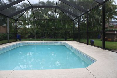 6 ft privacy fence and landscaping surrounding heated pool.