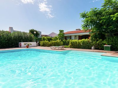 Photo for Bungalow with private garden in a small, quiet residence with shared pool