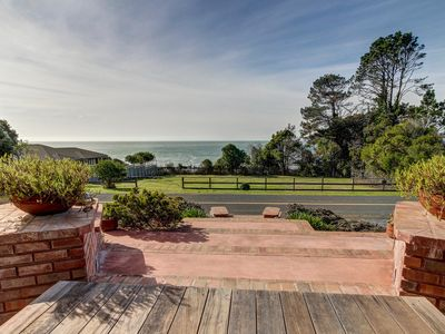 Photo for Spacious, dog-friendly, oceanfront home w/ private hot tub - walk to town!