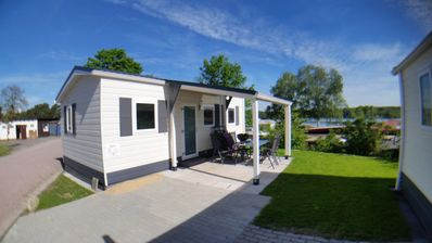 "Photo for House PARIS ""Enjoy freedom"" with terrace and barbecue near the lake Enjoy days of rest, relaxed holidays or a weekend away from everyday life. In our modern mobile homes you can expect comfortable living with a view over the camping lake in the immediate vicinity of the 1.5 km long sandy beach."