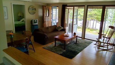 Living room, covered deck and screened porch