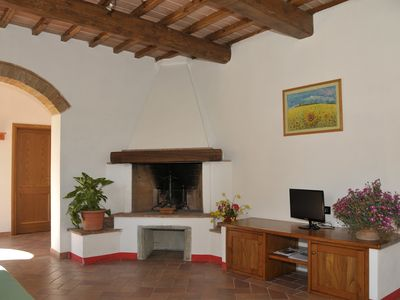 Photo for Spacious and elegant apartment near San Gimignano with swimming pool