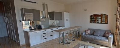 Panoramic photo of the new kitchen showing the entrance to the apartment on left