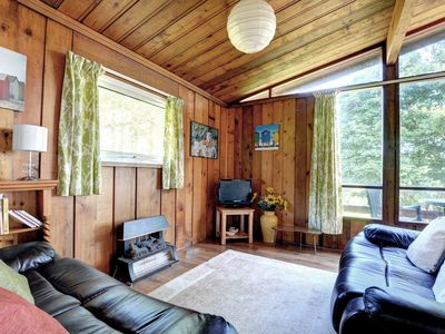 Photo for A detached cedarwood lodge located on the hillside within 130 acres of private David Bellamy Environ