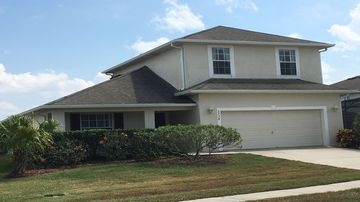 Beautiful 2 storey 4 bed pool home with lake view on gated golfing community.