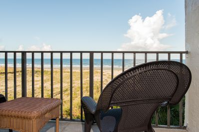 Large patio w/ over sized chairs and table.   This is a million dollar view!!!!!