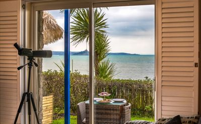the lounge with   views of the bay , the beach and the town 5 minutes walk