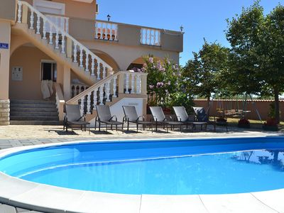 Photo for This 6-bedroom villa for up to 12 guests is located in Zadar and has a private swimming pool, air-co