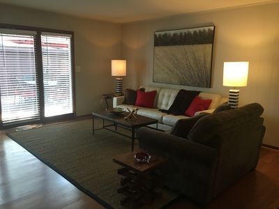 Large family room with French doors leading to large deck.