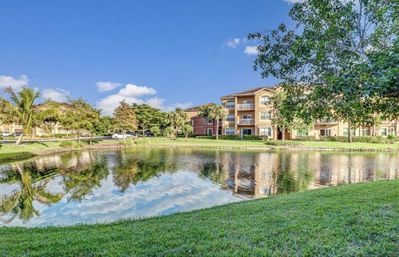 Photo for Charming lake view 2/2 Florida Condo minutes away from the beach