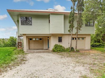 Photo for This 3 bedroom 2 bath home overlooks the Marsh with breathtaking views of Egan's Creek.