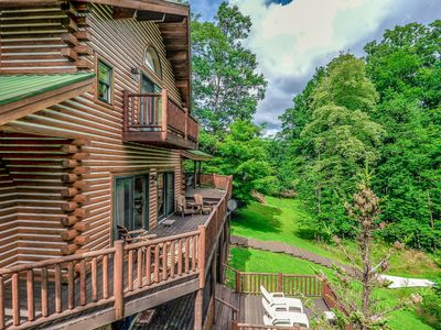 Lakefront home in wooded setting with private dock, hot tub and fire pit!