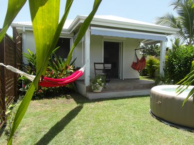 Photo for Bungalow with private spa 5 minutes walk from the beach of light grapes