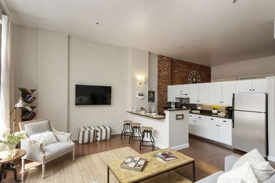 12' Ceilings and 100 year old exposed brick!