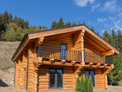 Photo for Beautiful wooden chalet near the top ski area of Nassfeld in the sunny south