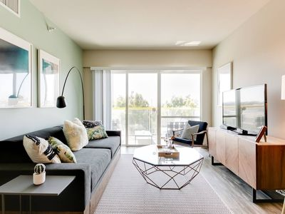 Photo for Bright Designer Apartment with Sunset Views & Pool