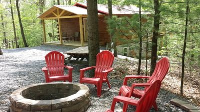 FIRE PIT WITH 8 ADIRONDACK CHAIRS TO ENJOY THE FIRE PIT TO ROAST MARSHMELLOWS