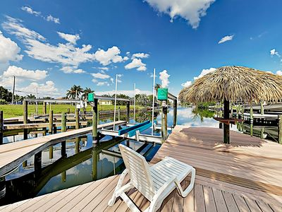 Photo for New Listing! Large Canal-Front Oasis w/ Screened Pool, Hot Tub, Dock Fishing