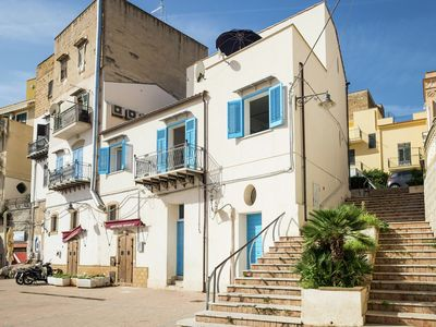 Photo for Tastefully decorated holiday home in the harbour of fishingvillage Porticello