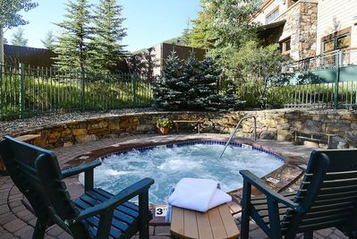Relax in one of the bubbling hot tubs at Zephyr Mountain Lodge