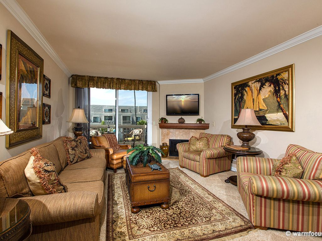 Beautifully upgraded living room fireplace and tommy bahama custom furniture