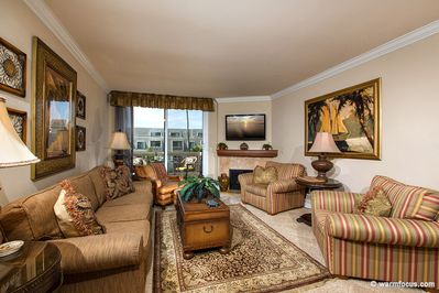 Beautifully upgraded living room. Fireplace and Tommy Bahama custom furniture.